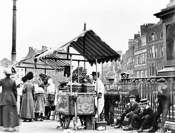 Ice cream sellers Market Place Nottingham Nottinghamshire c1910 The stall in the foreground belongs to Solari's who by the sound of the name were...