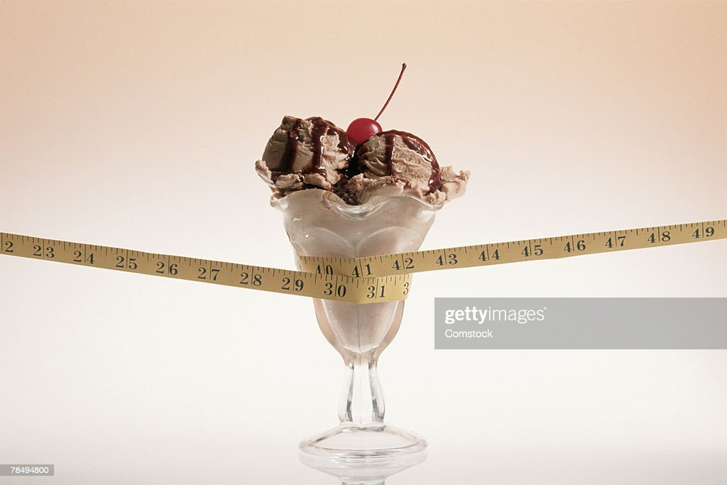 Ice cream sundae and tape measure : Stock Photo