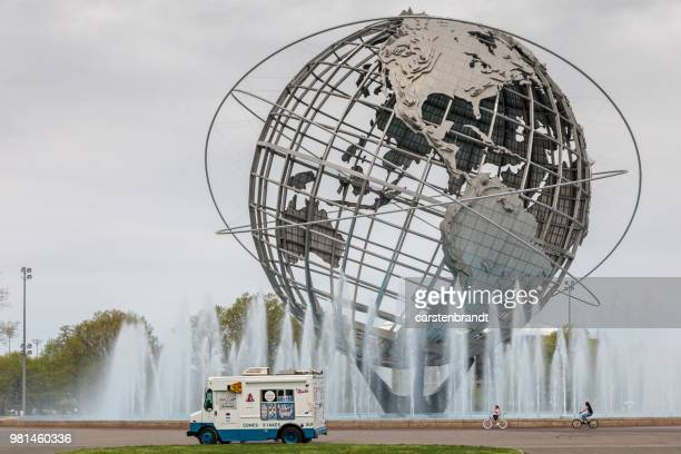 Ice cream truck in front of the world sphere