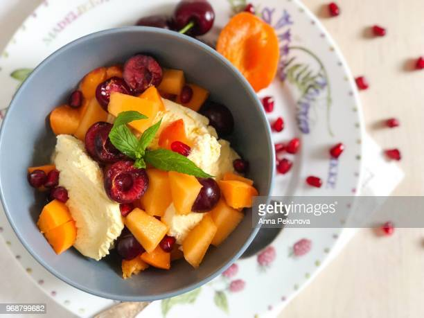 Ice cream with chopped colorful fruits