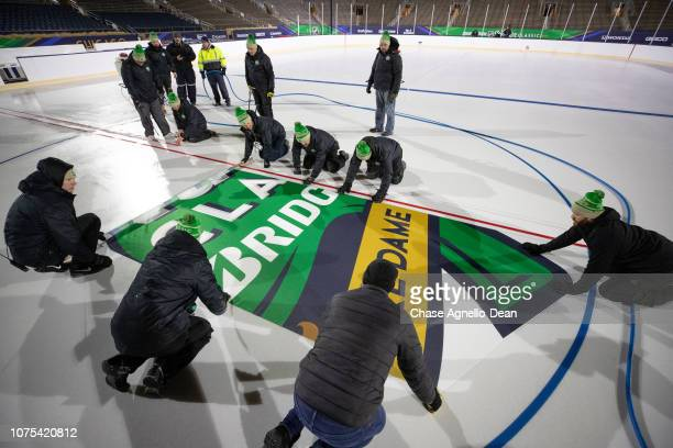 Ice Crew install the 2019 Bridgestone NHL Winter Classic logos at Notre Dame Stadium on December 28 2018 in South Bend Indiana