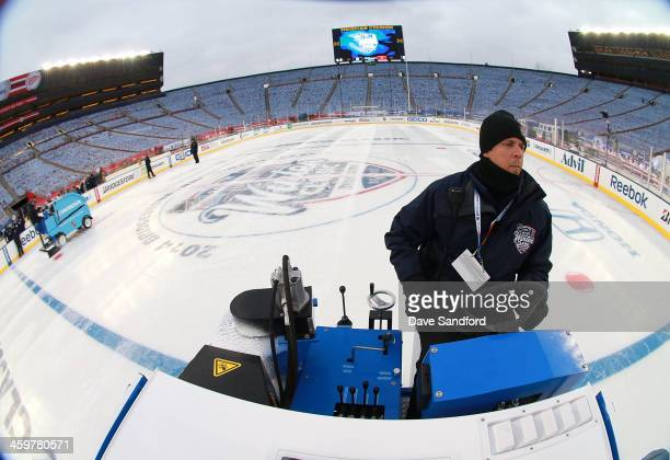 Ice crew member Francois Martindale resurfaces the ice with the Compact Ice Resurfacer during the 2014 Bridgestone NHL Winter Classic Build-out on...