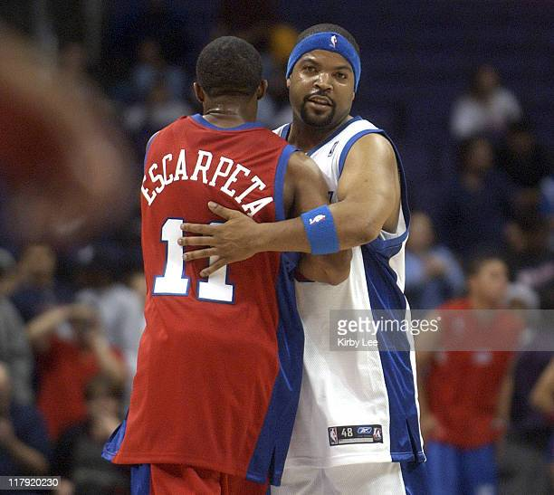 Ice Cube aka O'Shea Jackson embraces Arlen Escarpeta during Los Angeles Clippers Celebrity basketball game at the Staples Center in Los Angeles Calif...