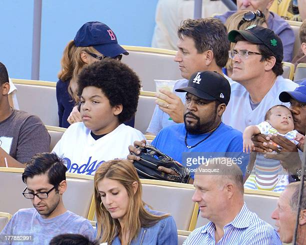 Ice Cube and his son attend a baseball game between the Boston Red Sox and the Los Angeles Dodgers at Dodger Stadium on August 25 2013 in Los Angeles...