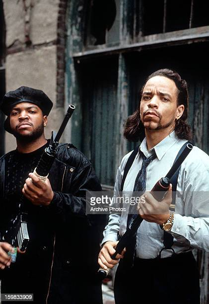 Ice Cube and Ice-T holding guns in a scene from the film 'Trespass', 1992.