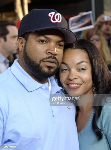 Ice Cube and wife Kim Jackson during War of the Worlds Los Angeles Premiere and Fan Screening Arrivals at Grauman's Chinese Theater in Los Angeles...