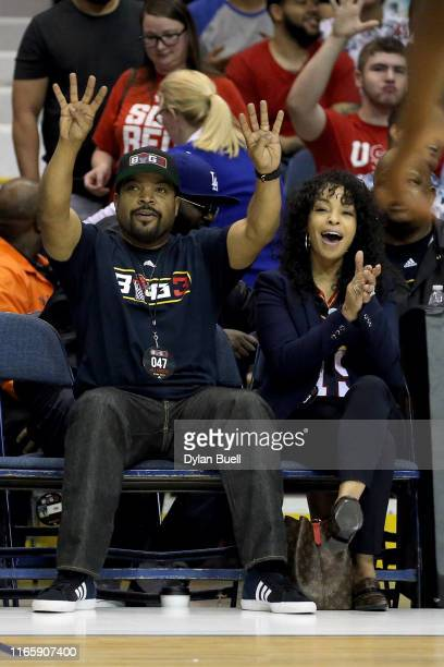 Ice Cube and wife Kimberly Woodruff celebrate during week seven of the BIG3 three on three basketball league at Allstate Arena on August 03 2019 in...