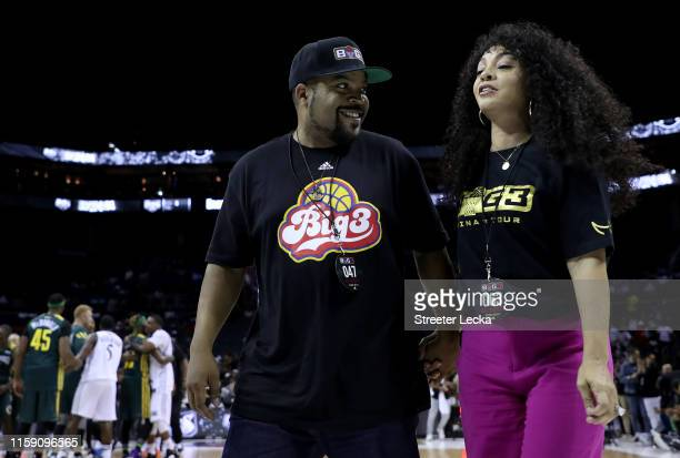 Ice Cube and wife Kimberly Woodruff walk off court during week two of the BIG3 three on three basketball league at Spectrum Center on June 29, 2019...