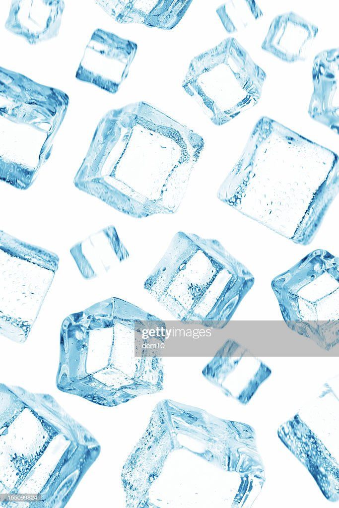 Ice cube falling on the sky : Stock Photo