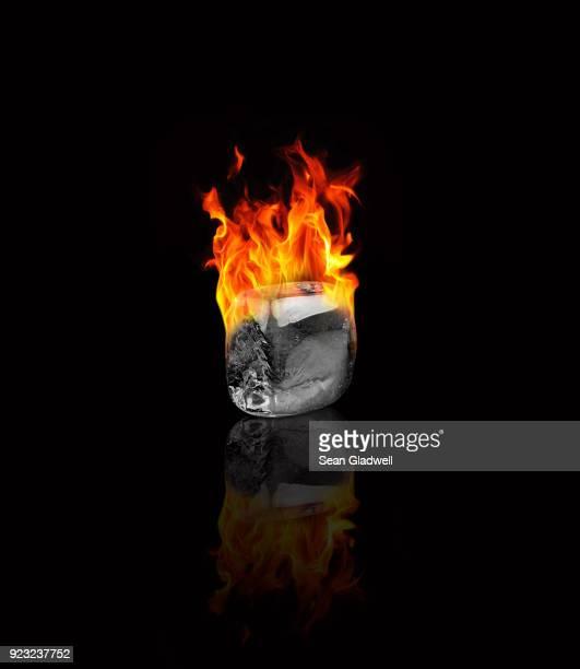 ice cube on fire - solidità foto e immagini stock