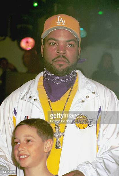 Ice Cube rear wears a Los Angeles Lakers home shooting shirt and tearaway pants during the NBAcom Celebrity Fashion Show Auction April 27 2000 at the...