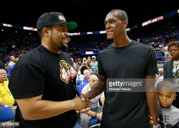 Ice Cube shakes the hand of Rajon Rondo during week seven of the BIG3 three on three basketball league at Rupp Arena on August 6 2017 in Lexington...