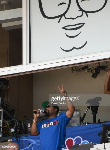 Ice Cube sings 'Take Me Out to the Ball Game' during the seventh inning stretch in a game between the Chicago Cubs and the St Louis Cardinals on July...
