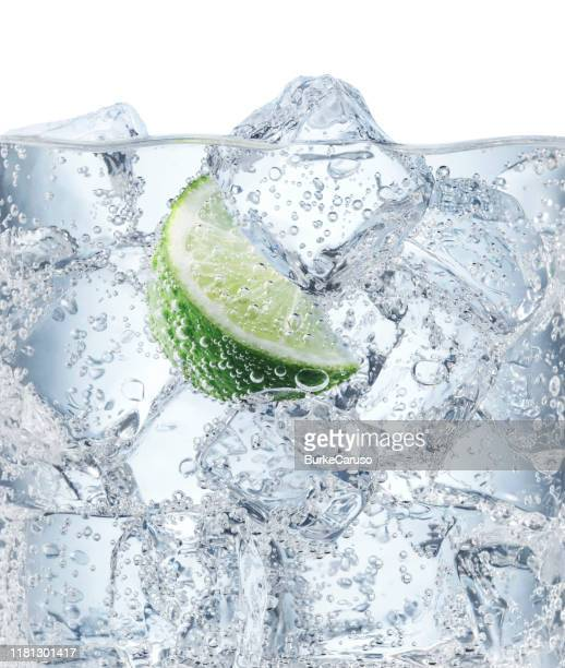 ice cubes and lime in soda water - ソーダ類 ストックフォトと画像