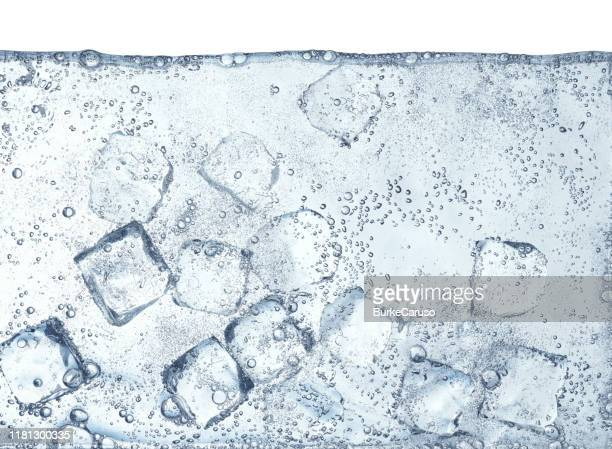 ice cubes floating in water - ソーダ類 ストックフォトと画像
