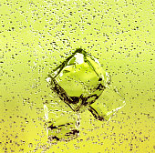 juice with ice cubes bubbles