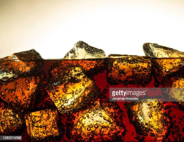 ice cubes in soda - ice stock pictures, royalty-free photos & images