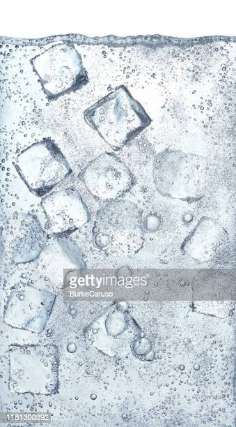 ice cubes in water - ソーダ類 ストックフォトと画像