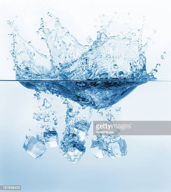 Ice cubes splashing into the water