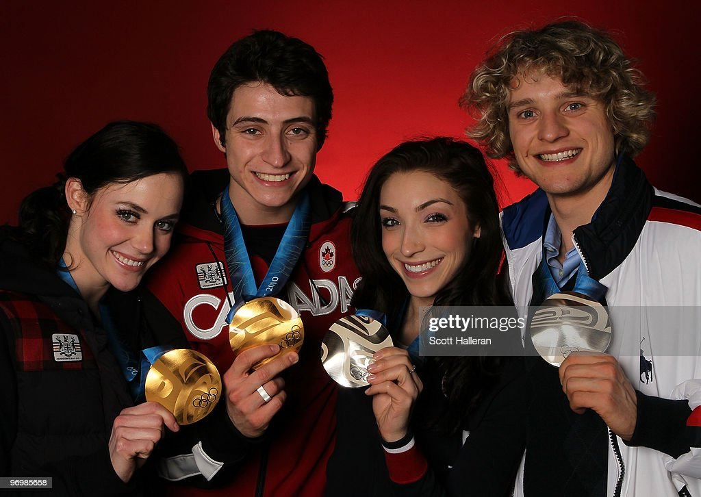 Ice dance figure skaters Tessa Virtue and Scott Moir of Canada, pose with their gold medals alongside silver medal winners Meryl Davis and Charlie White of the United States in the NBC Today Show Studio at Grouse Mountain on February 23, 2010 in North Vancouver, Canada.