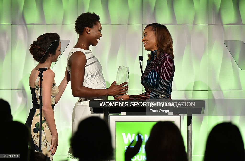 Ice Dancer Meryl Davis (L) and Track & Field athlete Sanya Richards-Ross (R) present Water Polo player Ashleigh Johnson with the Individual Sportswoman of the Year award at the 37th Annual Salute To Women In Sports Gala at Cipriani Wall Street on October 19, 2016 in New York City.