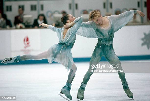 Ice dancers Maya Usova and Alexander Zhulin of Russia en route to winning the bronze medal at the Winter Olympic Games in Albertville circa February...