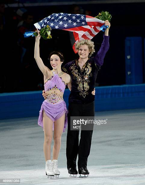 Ice dancing gold medalists Meryl Davis and Charlie White of he USA take a victory lap with an American flag following the flower ceremony at the...