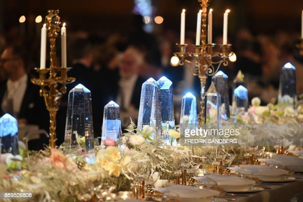 Ice decorations and flowers are pictured on the table of honour during the Nobel banquet in the City Hall of Stockholm on December 10 2017 / AFP...