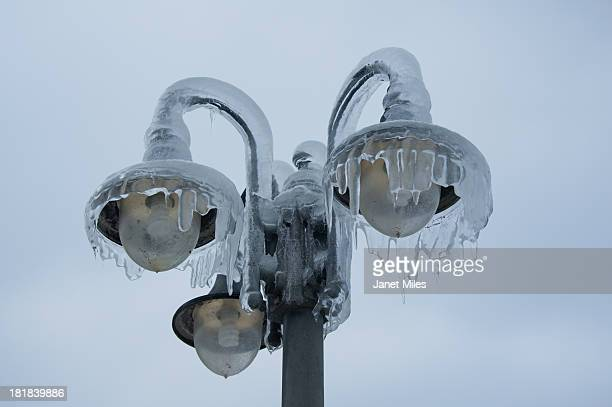 ice dripping from street lights