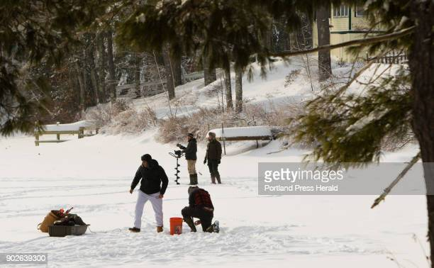 Ice fishermen brave subzero temps for the chance t catch trout on Barker Pond in Lyman on Saturday December 30 2017 Photo by Carl D Walsh/Portland...