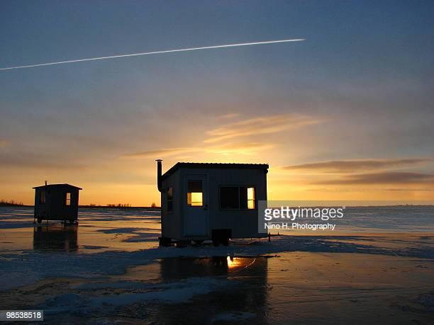 Ice fishing at sunset - Quebec