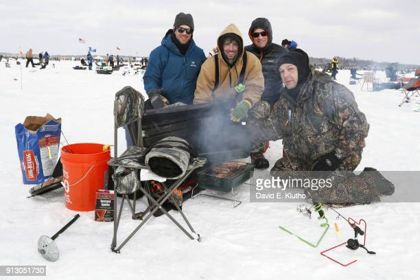Brainerd Jaycees Ice Fishing Extravaganza Contestants pose with grilled food and beers during event on Brainerd Lakes Contestants came from 38 states...