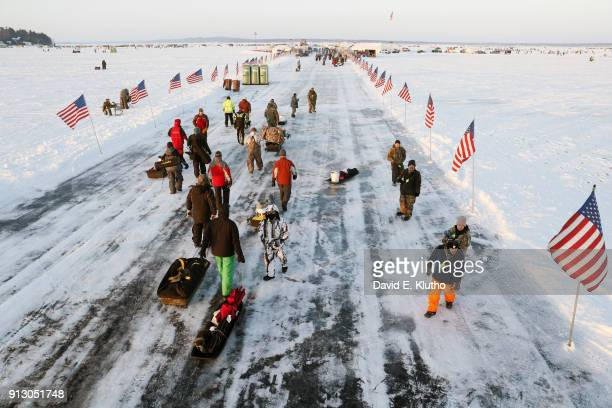 Brainerd Jaycees Ice Fishing Extravaganza Contestants carry equipment on sleds during event on Brainerd Lakes Contestants came from 38 states and at...