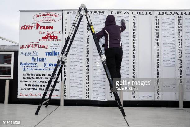 Brainerd Jaycees Ice Fishing Extravaganza Event volunteers adjust the Big Fish Leaderboard to update the largest fish caught during event on Brainerd...