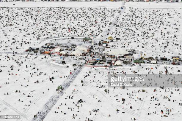 Brainerd Jaycees Ice Fishing Extravaganza Overall view of contestants gathered around town constructed on ice in center of Gull Lake during event on...