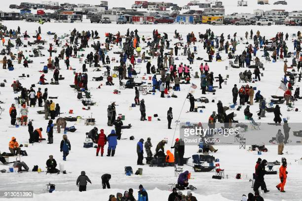 Brainerd Jaycees Ice Fishing Extravaganza Overall view of contestants gathered on the ice during event on Brainerd Lakes Contestants came from 38...