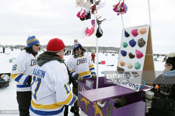 Brainerd Jaycees Ice Fishing Extravaganza Participants playing 'Bra Pong' to raise money for breast cancer awareness during event at Brainerd Lakes...