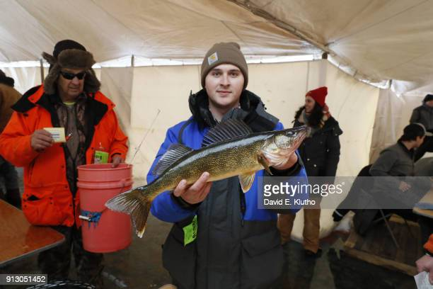 Brainerd Jaycees Ice Fishing Extravaganza View of contestant holding a Walleye fish after placing second overall during event on Brainerd Lakes...