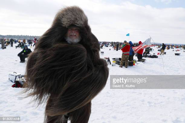 Brainerd Jaycees Ice Fishing Extravaganza View of contestant in large fur jacket during event on Brainerd Lakes Contestants came from 38 states and...