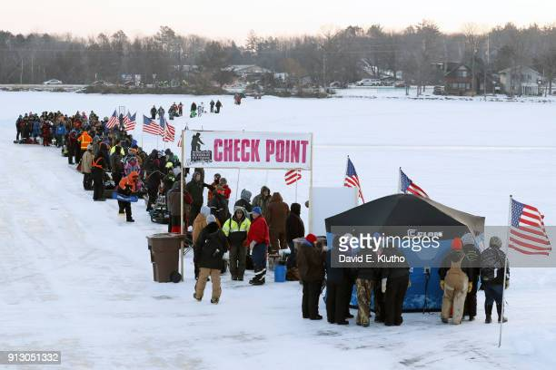 Brainerd Jaycees Ice Fishing Extravaganza View of contestants lined up at check point during event on Brainerd Lakes Contestants came from 38 states...