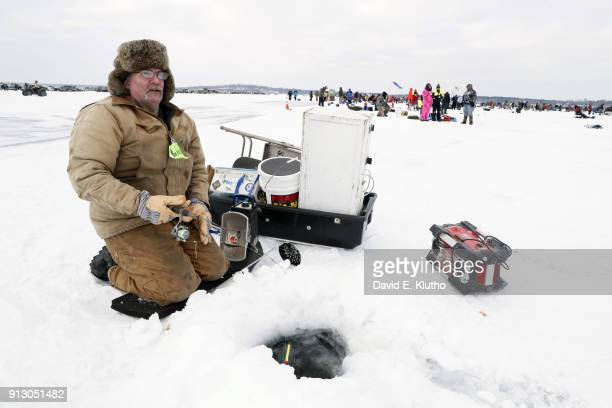 Brainerd Jaycees Ice Fishing Extravaganza View of contestant fishing during event on Brainerd Lakes Contestants came from 38 states and at least 6...