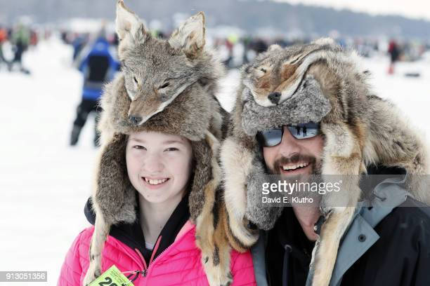 Brainerd Jaycees Ice Fishing Extravaganza View of contestants Peter and Dakota wearing coyote hats during event on Brainerd Lakes Contestants came...