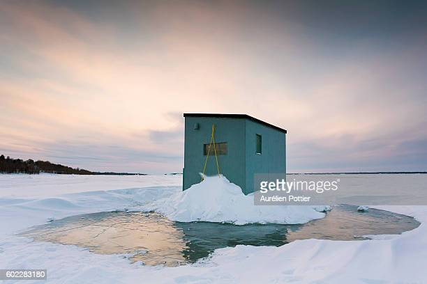 ice fishing house on ice - shack stock pictures, royalty-free photos & images