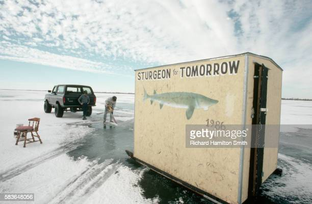 ice fishing hut on lake winnebago - sturgeon stock pictures, royalty-free photos & images