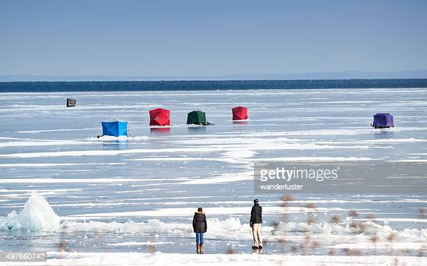 ice fishing huts on lake superior - hut stock pictures, royalty-free photos & images
