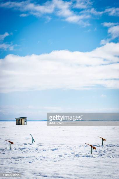 ice fishing in canada. - ice fishing stock pictures, royalty-free photos & images