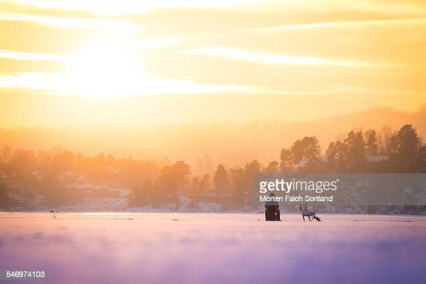 ice fishing in february - ice fishing stock pictures, royalty-free photos & images