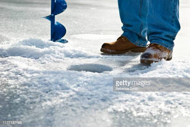 ice fishing - ice fishing stock pictures, royalty-free photos & images