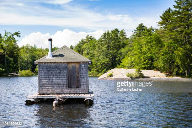 ice fishing shack on pristine lake in maine - catherine ledner stock pictures, royalty-free photos & images
