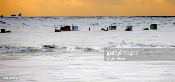 Ice fishing takes place in the morning on an ice flow at the the Outardes River in Baie Comeau Québec on Jan 20 2018 Massachusetts bids for lucrative...